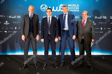 Stock Photo of (L-R) FIFA Referees Committee chairman Pierluigi Collina of Italy, Spanish Royal Soccer Federation (RFEF) Referees Committee chairman Carlos Velasco Carballo, UEFA chief refereeing officer Roberto Rosetti of Italy, and sport lawyer Alberto Palomar pose for photographers during the conference 'Refereeing and VAR: experiences, application and development' in the frane of the World Soccer Congress organized by the RFEF in Barcelona, Spain, 12 April 2019.