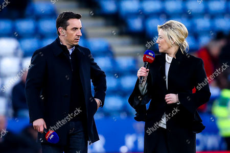 Stock Picture of Sky Sports Presenter Kelly Cates has an animated conversation with pundit and former Manchester United and England defender Gary Neville