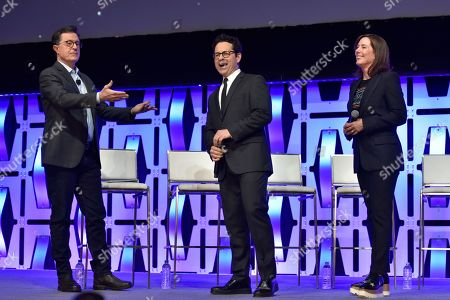 """Stephen Colbert, J.J. Abrams, Kathleen Kennedy. Stephen Colbert, from left, J.J. Abrams and Kathleen Kennedy participate during the """"Star Wars: The Rise Of Skywalker"""" panel on day 1 of the Star Wars Celebration at Wintrust Arena, in Chicago"""