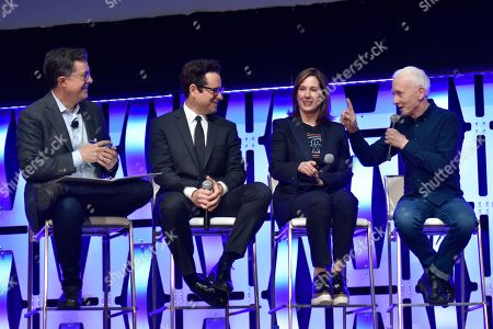"""Stephen Colbert, J.J. Abrams, Kathleen Kennedy, Anthony Daniels. Stephen Colbert, from left, J.J. Abrams, Kathleen Kennedy and Anthony Daniels participate during the """"Star Wars: The Rise Of Skywalker"""" panel on day 1 of the Star Wars Celebration at Wintrust Arena, in Chicago"""