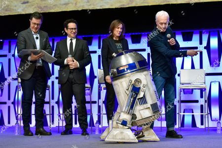 """Stephen Colbert, J.J. Abrams, Kathleen Kennedy, Anthony Daniels, R2-D2. Stephen Colbert, from left, J.J. Abrams, Kathleen Kennedy, R2-D2 and Anthony Daniels participate in the """"Star Wars: The Rise of Skywalker"""" panel on day 1 of the Star Wars Celebration at Wintrust Arena, in Chicago"""