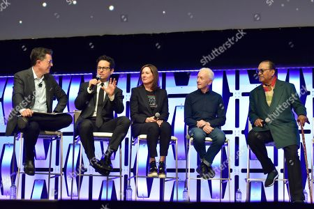 """Stephen Colbert, J.J. Abrams, Kathleen Kennedy, Anthony Daniels, Billy Dee Williams. Stephen Colbert, from left, J.J. Abrams, Kathleen Kennedy, Anthony Daniels and Billy Dee Williams participate in the """"Star Wars: The Rise of Skywalker"""" panel on day 1 of the Star Wars Celebration at Wintrust Arena, in Chicago"""
