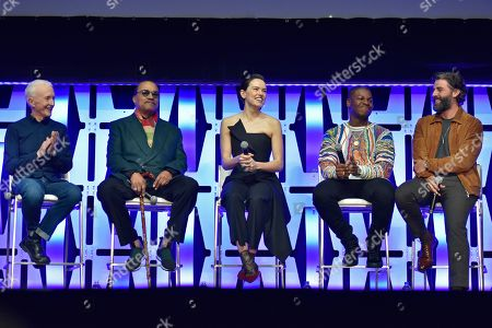 """Anthony Daniels, Billy Dee Williams, Daisy Ridley, John Boyega, Oscar Isaac. Anthony Daniels, from left, Billy Dee Williams, Daisy Ridley, John Boyega and Oscar Isaac participate during the """"Star Wars: The Rise of Skywalker"""" panel on day 1 of the Star Wars Celebration at Wintrust Arena, in Chicago"""