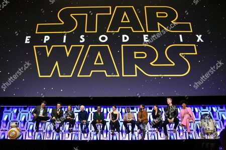 """Stephen Colbert, J.J. Abrams, Kathleen Kennedy, Anthony Daniels, Billy Dee Williams, Daisy Ridley, John Boyega, Oscar Isaac, Kelly Marie Tran, Joonas Suotamo, Naomi Ackie. Stephen Colbert, from left, J.J. Abrams, Kathleen Kennedy, Anthony Daniels, Billy Dee Williams, Daisy Ridley, John Boyega, Oscar Isaac, Kelly Marie Tran, Joonas Suotamo and Naomi Ackie participate in the """"Star Wars: The Rise of Skywalker"""" panel on day 1 of the Star Wars Celebration at Wintrust Arena, in Chicago"""