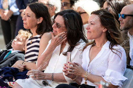 US actor Billy Crystal's wife Janice Crystal (C) and family react as he delivers a speech during his hands and footprints ceremony at the Grauman's Chinese Theater in Hollywood, California, USA, 12 April 2019.