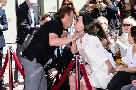 Billy Crystal (L) kisses his wife Janice Crystal during his hands and footprints ceremony at the Grauman's Chinese Theater in Hollywood, California, USA, 12 April 2019.