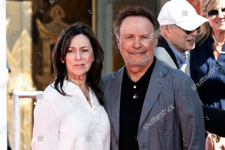 Billy Crystal (R) and his wife Janice Crystal (L) pose for the photographers after he was honored with hands and footprints ceremony at the Grauman's Chinese Theater in Hollywood, California, USA, 12 April 2019.