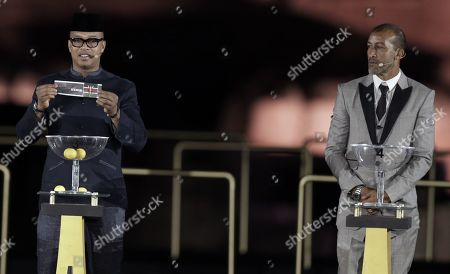 Former Senegalese striker El Hadji Diouf  draws during the Draw for the 32nd edition of the Africa Cup of Nations (AFCON) soccer tournament, in Giza, Egypt, 12 April 2019. The 32nd edition of the Africa Cup of Nations to be hosted by Egypt is set to take place in June 2019.