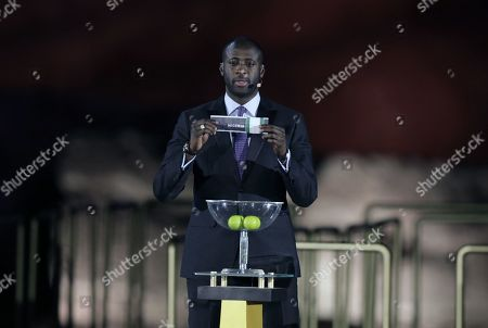 Former Ivorian midfielder Yaya Toure draws during the Draw for the 32nd edition of the Africa Cup of Nations (AFCON) soccer tournament, in Giza, Egypt, 12 April 2019. The 32nd edition of the Africa Cup of Nations to be hosted by Egypt is set to take place in June 2019.