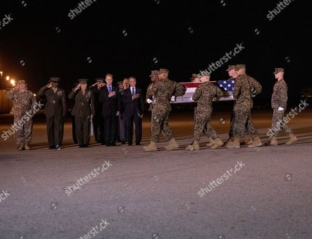 Stock Image of Members of the Official Party, including Governor John Carney (Democrat of Delaware), Sergeant Major of the United States Marine Corps Ronald Green, US Marine Corps General Robert B. Neller, Commandant of the Marine Corps, acting US Secretary of Defense Patrick M. Shanahan, and US Air Force Colonel Matthew Jones, 436th Airlift Wing, Vice Commander, pay their respects as a US Marine Corps carry team participates in the Dignified Transfer of the transfer case containing the remains of United States Marine Corps Staff Sergeant Christopher A. Slutman at Dover Air Force Base