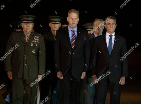 Members of the Official Party, including Governor John Carney (Democrat of Delaware), Sergeant Major of the United States Marine Corps Ronald Green, US Marine Corps General Robert B. Neller, Commandant of the Marine Corps, acting US Secretary of Defense Patrick M. Shanahan, and US Air Force Colonel Matthew Jones, 436th Airlift Wing, Vice Commander, pay their respects as a US Marine Corps carry team participates in the Dignified Transfer of the transfer case containing the remains of United States Marine Corps Staff Sergeant Christopher A. Slutman at Dover Air Force Base