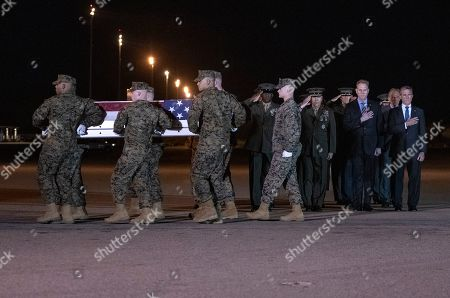 Members of the Official Party, including Governor John Carney (Democrat of Delaware), Sergeant Major of the United States Marine Corps Ronald Green, US Marine Corps General Robert B. Neller, Commandant of the Marine Corps, and acting US Secretary of Defense Patrick M. Shanahan, salute as a US Marine Corps carry team participates in the Dignified Transfer of the transfer case containing the remains of United States Marine Corps Staff Sergeant Christopher A. Slutman at Dover Air Force Base