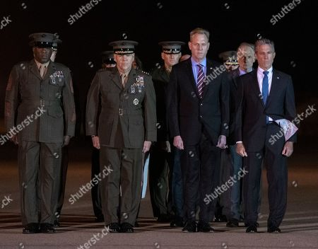 Stock Photo of Members of the Official Party, including Governor John Carney (Democrat of Delaware), Sergeant Major of the United States Marine Corps Ronald Green, US Marine Corps General Robert B. Neller, Commandant of the Marine Corps, acting US Secretary of Defense Patrick M. Shanahan, and US Air Force Colonel Matthew Jones, 436th Airlift Wing, Vice Commander, pay their respects as a US Marine Corps carry team participates in the Dignified Transfer of the transfer case containing the remains of United States Marine Corps Staff Sergeant Christopher A. Slutman at Dover Air Force Base