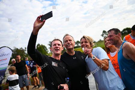 Australian Opposition Leader Bill Shorten and Senator Kristina Keneally take a selfie after crossing the finish line of the Mt Penang Gardens Parkrun in Gosford, 13 April 2019.