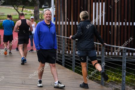 Australian Opposition Leader Bill Shorten reacts as Senator Kristina Keneally stretches ahead of the Mt Penang Gardens Parkrun in Gosford, 13 April 2019.