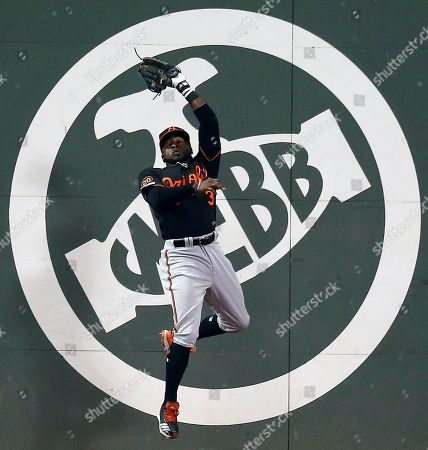Baltimore Orioles' Dwight Smith Jr. makes the catch on a fly-out by Boston Red Sox's J.D. Martinez during the fourth inning of a baseball game in Boston, Friday, April, 12, 2019