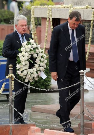 Sir Dominic Anthony Gerard Asquith (R), the British High Commissioner to India, walks to lay a wreath to pay tributes to the martyrs of the Jallianwala Bagh Massacre on the occasion of massacre's 100th anniversary at the Jallianwala Bagh Memorial in Amritsar, India, 13 April 2019. The year 2019 marks the centenary of the Jallianwala Bagh Massacre. On 13 April 1919, the then Lieutenant Governor of the Punjab, General Sir Michael O'Dwyer ordered British Gurkha troops, under the command of Brigadier-General Reginald Edward Harry Dyer, to open fire at a mass gathering at the Jallianwala Bagh, which later came to be known as the Amritsar Massacre or the Jallianwala Bagh massacre. Jallianwala Bagh massacre has been termed as a key turning point towards India's independence from the British rule. Official British Raj sources estimated the massacre fatalities at 379 with 1,100 wounded, however, the Indian National Congress estimates that over 1,000 died in the event.