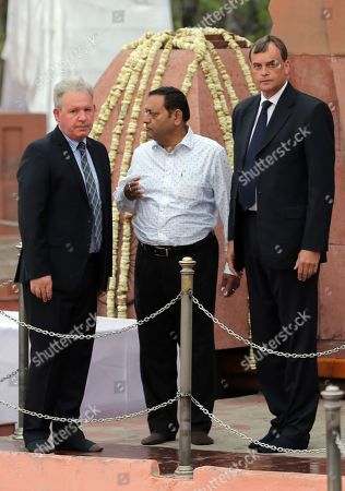 Stock Image of Sir Dominic Anthony Gerard Asquith (R), the British High Commissioner to India, stands along with Jallianwala Bagh trust secretary S K Mukherjee (C) and an unidentified official after laying a wreath to pay tributes to the martyrs of the Jallianwala Bagh Massacre on the occasion of massacre's 100th anniversary at the Jallianwala Bagh Memorial in Amritsar, India, 13 April 2019. The year 2019 marks the centenary of the Jallianwala Bagh Massacre. On 13 April 1919, the then Lieutenant Governor of the Punjab, General Sir Michael O'Dwyer ordered British Gurkha troops, under the command of Brigadier-General Reginald Edward Harry Dyer, to open fire at a mass gathering at the Jallianwala Bagh, which later came to be known as the Amritsar Massacre or the Jallianwala Bagh massacre. Jallianwala Bagh massacre has been termed as a key turning point towards India's independence from the British rule. Official British Raj sources estimated the massacre fatalities at 379 with 1,100 wounded, however, the Indian National Congress estimates that over 1,000 died in the event.