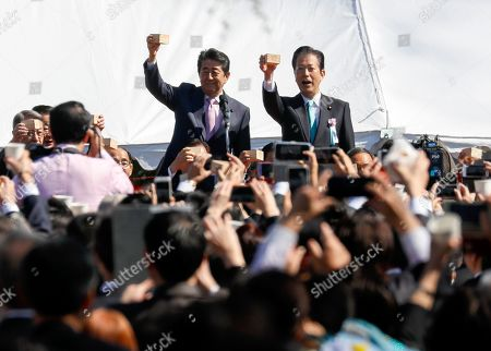 Japanese Prime Minister Shinzo Abe (L) and ruling coalition partner New Komeito President Natsuo Yamaguchi make toasts during a cherry blossom viewing party held by prime minister at Shinjuku Gyoen Park in Tokyo, Japan, 13 April 2019. About 18,000 guests were invited to the outdoor party.