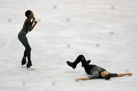 France's Vanessa James and Morgan Cipres react after performing their pairs free program routine during the ISU World Team Trophy Figure Skating competition in Fukuoka, southwestern Japan