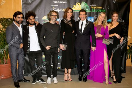 (L-R) Spanish Flamenco guitarist Daniel Casares; Flamenco singer Lin Cortes; British pianist James Rhodes; Spanish model Nieves Alvarez; Spanish actor Antonio Banderas; his girlfriend Nicole Kimpel (R) and her sister Barbara Kimpel, pose for the photographers upon their arrival at the charity dinner, organized by Fundacion Lagrimas y Favores foundation at Edgar Nevile hall, in Malaga, southern Spain, late 12 April 2019. Banderas chaired the event.