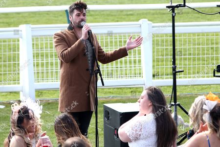 BEN HAENOW an X Factor Winner sings 5000 Miles to the crowd prior to the Scottish Grand National race day at Ayr Racecourse, Ayr
