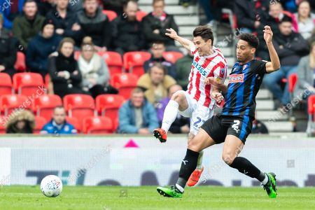 Stock Photo of Bojan Krkic (27) of Stoke City and Zak Vyner (2) of Rotherham United contest the ball