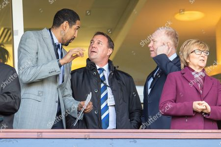 Stock Image of Glasgow Rocks basketball player Kieron Achara (left) speaks with Malky Mackay, he SFA Performance Director (centre) and Alex McLeish, the Scotland national team manager before the William Hill Scottish Cup semi-final match between Heart of Midlothian and Inverness CT at Hampden Park, Glasgow