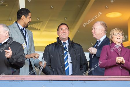 Stock Picture of Glasgow Rocks basketball player Kieron Achara (left) speaks with Malky Mackay, he SFA Performance Director (centre) and Alex McLeish, the Scotland national team manager before the William Hill Scottish Cup semi-final match between Heart of Midlothian and Inverness CT at Hampden Park, Glasgow