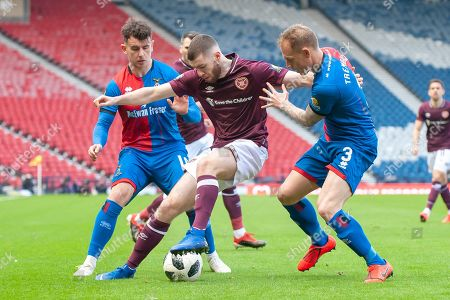 Stock Picture of Aidan Keena (#35) of Heart of Midlothian FC holds the ball up between Aaron Doran (#10) and Carl Tremarco (#3) of Inverness Caledonian Thistle FC during the William Hill Scottish Cup semi-final match between Heart of Midlothian and Inverness CT at Hampden Park, Glasgow