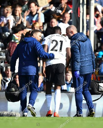 Stock Image of Timothy Fosu Mensah of Fulham goes off injured