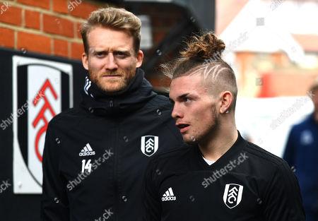 Harvey Elliott of Fulham alongside fellow substitute Andre Schurrle