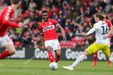 Middlesbrough midfielder John Obi Mikel (2) plays a through ball as Hull City midfielder Jackson Irvine (16) tries to cut it out during the EFL Sky Bet Championship match between Middlesbrough and Hull City at the Riverside Stadium, Middlesbrough