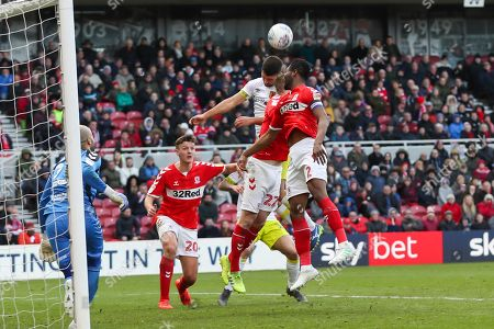 Middlesbrough midfielder John Obi Mikel (2) Middlesbrough midfielder George Saville (22) and Hull City defender Eric Lichaj (2) challenge for the ball during the EFL Sky Bet Championship match between Middlesbrough and Hull City at the Riverside Stadium, Middlesbrough