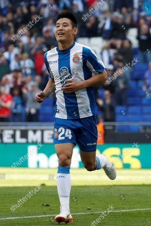 Stock Photo of RCD Espanyol's Chinese Wu Lei (C) celebrates after his teammate Adria Pedrosa (unseen) scored against Deportivo Alaves during their LaLiga soccer game at RCDE Stadium in Cornella-El Prat, Barcelona, northeastern Spain, 13 April 2019.
