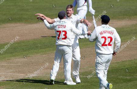 Timm Van Der Gugten of Glamorgan celebrates the wicket of Robert Newton with David Lloyd.