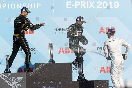 Race winner Jaguar Racing's New Zealand driver Mitch Evans (C), runner-up Techeetah's German driver Andre Lotterer (L) and third-placed HWA AG's Belgian driver Stoffel Vandoorne stand at attention during the podium ceremony after the Rome E-Prix leg of the Formula E season 2018-2019 electric car championship in the EUR district of Rome on April 13, 2019.