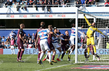 Kristoffer Nordfeldt goalkeeper of Swansea City  saves as Bright Osayi-Samuel of QPR  challenges