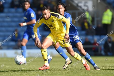 Oxford United midfielder (on loan from Wolverhampton Wanderers) Jordan Graham (18) under pressure from AFC Wimbledon defender Toby Sibbick (20) during the EFL Sky Bet League 1 match between Oxford United and AFC Wimbledon at the Kassam Stadium, Oxford