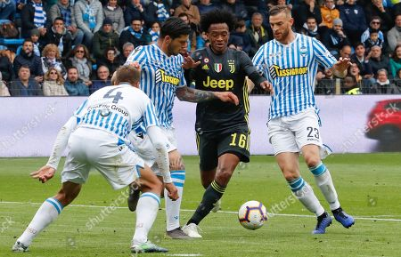 From left, Spal's Thiago Cionek, Spal's Kevin Bonifazi, Juventus' Juan Cuadrado and Spal's Francesco Vicari go for the ball during the Serie A soccer match between Spal and Juventus, at the Paolo Mazza stadium in Ferrara, Italy