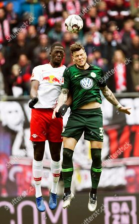 Stock Image of Wolfsburg's Daniel Ginczek, right, challenges for the ball against Leipzig's Ibrahima Konate, left, during the German Bundesliga soccer match between RB Leipzig and VfL Wolfsburg in Leipzig, Germany