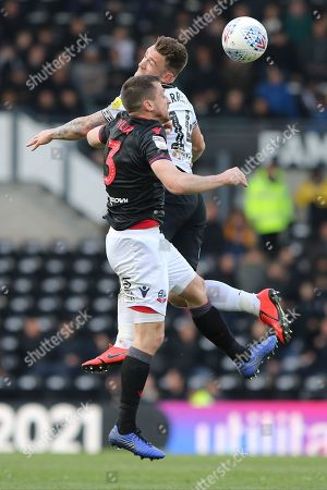 Stock Photo of Derby County forward Jack Marriott and Bolton Wanderers defender Andrew Taylor challenge for the ball during the EFL Sky Bet Championship match between Derby County and Bolton Wanderers at the Pride Park, Derby