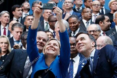Swedish Minister for Finance Magdalena Andersson (C) takes a selfie with German Finance Minister Olaf Scholz (L) and Canadian Finance Minister Bill Morneau (R) prior to the IMFC meeting at IMF headquarters in Washington, DC, USA, 13 April 2019. International Monetary Fund World Bank Group Spring Meetings runs from 09 - 13 April 2019.