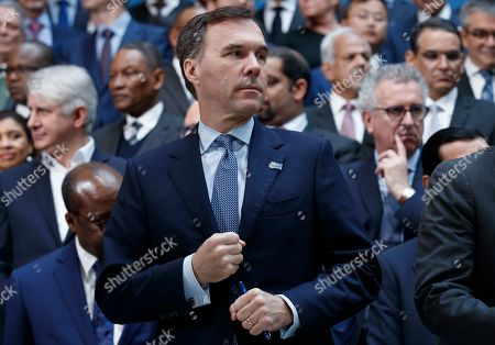 Canadian Finance Minister Bill Morneau (C) prior to the IMFC meeting at IMF headquarters in Washington, DC, USA, 13  April 2019. International Monetary Fund World Bank Group Spring Meetings runs from 09 - 13 April 2019.