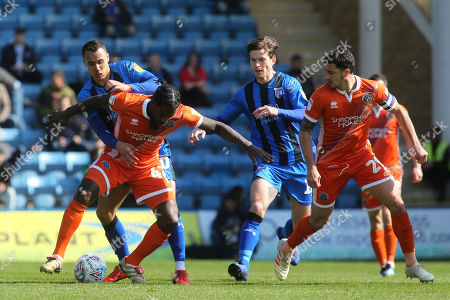Anthony Grant of Shrewsbury shields the ball from Gillingham's Graham Burke during Gillingham vs Shrewsbury Town, Sky Bet EFL League 1 Football at The Medway Priestfield Stadium on 13th April 2019