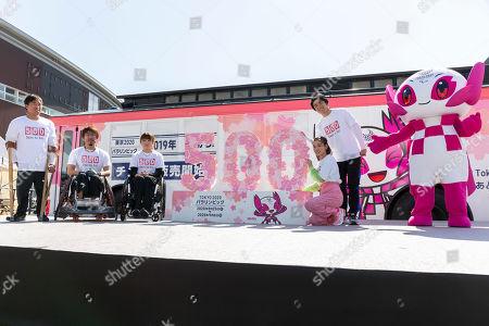Stock Image of Paralympic athlete Jumpei Kimura, badminton player Sarina Satomi, wheelchair rugby player Daisuke Ikezaki, actress Riisa Naka and actor Akiyoshi Nakao, pose for the cameras during a talk show