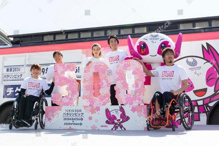 Stock Picture of Badminton player Sarina Satomi, Paralympic athlete Jumpei Kimura, actress Riisa Naka and actor Akiyoshi Nakao and wheelchair rugby player Daisuke Ikezaki, pose for the cameras during a talk show