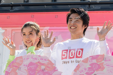 Japanese actress Riisa Naka and actor Akiyoshi Nakao pose for the cameras during a talk show