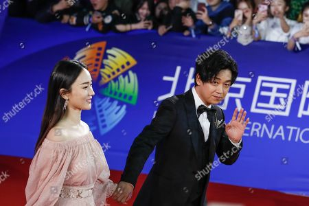 Stock Image of Pan Yueming (R) and Huo Siyan arrive for the opening ceremony red carpet event of the 9th Beijing International Film Festival, in Beijing, China, 13 April 2019. The film festival runs from 13 to 20 April.