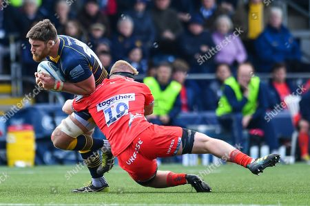 Darren Barry of Worcester Warriors is tackled by Matt Postlethwaite of Sale Sharks